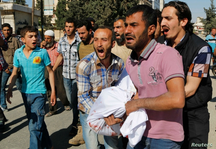 Men react as they carry the body of a relative, whom activists say was killed by barrel bombs dropped by forces loyal to Syria's President Bashar al-Assad in Aleppo's al-Sakhour district, April 30, 2014.