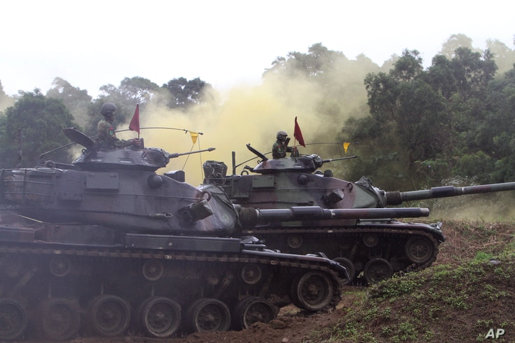Taiwanese soldiers operate M60-A3 tanks during a military exercise in Hualien, Taiwan, Wednesday, Jan. 23, 2013. (AP Photo/Chiang Ying-ying)