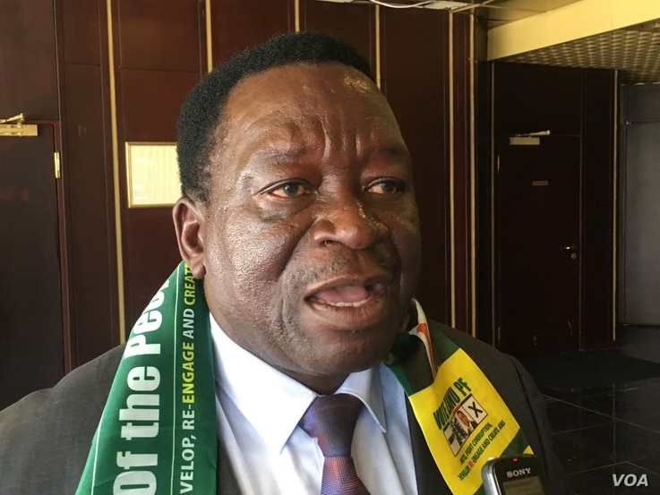Victor Matemadanda, the war veterans' secretary, is among those who accuse the US of interference in Zimbabwean politics. In the photo, (08/21/2018) he talks to reporters in Harare.