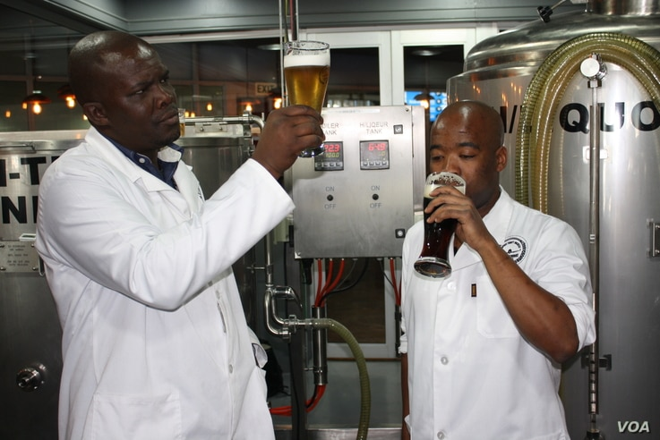 Chief brewer Phumelelo Marali (left) and his trainee Sibusiso Khumalo check the quality of some of their beer inside Africa's first airport-based brewery at O.R. Tambo International, near Johannesburg, South Africa.