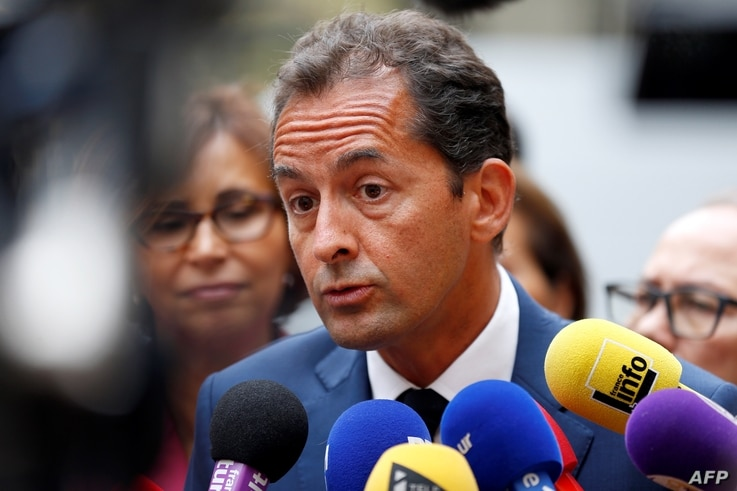 FILE - French essayist Hakim El Karoui speaks to journalists following a meeting with French Interior Minister and Islam representatives at the Interior Ministry, in Paris, Aug.  29, 2016.