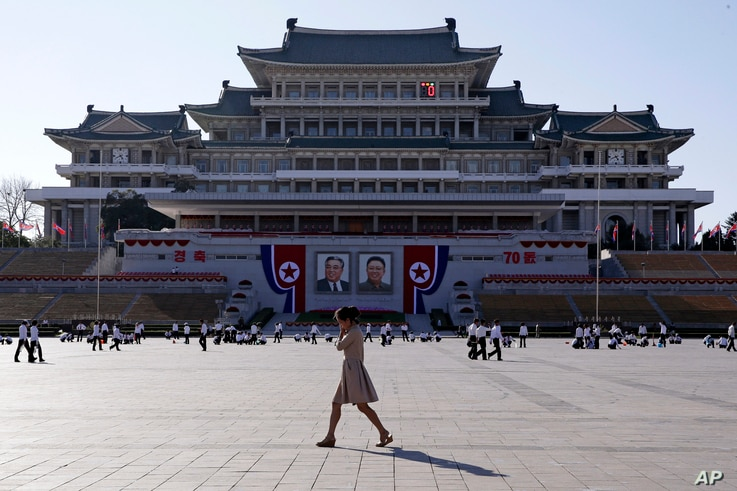 A woman walks past the preparations ongoing on Kim Il Sung Square, ahead of the 70th anniversary of North Korea's founding day in Pyongyang, North Korea, Sept. 7, 2018.