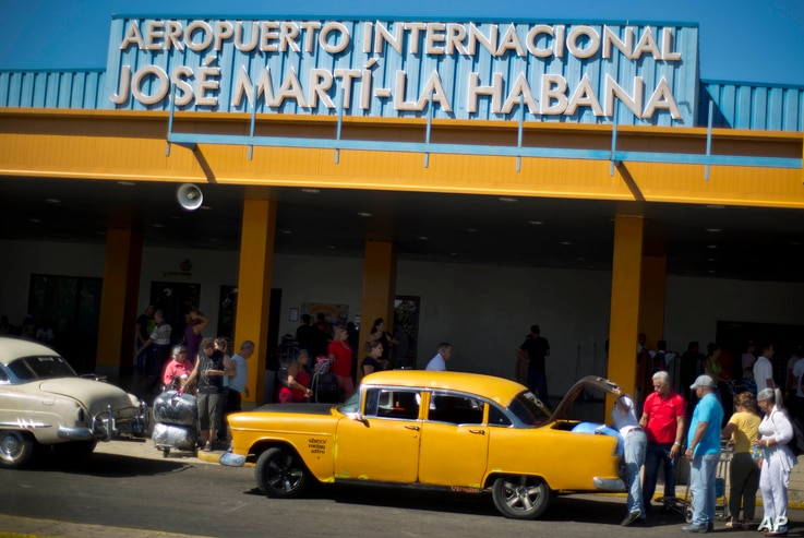 FILE - People put their luggage in a private taxi as they arrive from the U.S. to the Jose Marti International Airport in Havana, Cuba, Sept. 1, 2014.