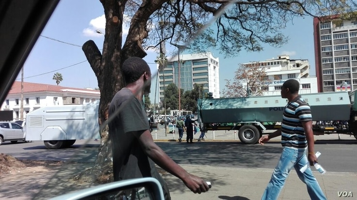 Water cannons and riot police patrol in streets of Harare looking for possible pockets of resistance after protestors were violently dispersed by Zimbabwean police, Harare, Zimbabwe, Aug. 17, 2016. (S. Mhofu/VOA)