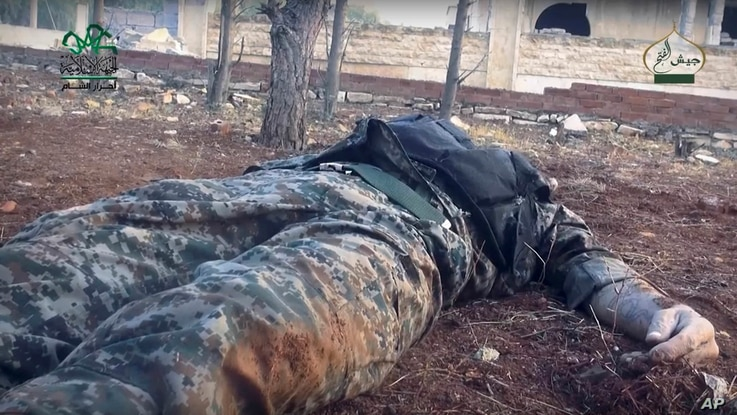 This image posted online by the Ahrar al-Sham militant group purports to show a dead Syrian soldier in a government-controlled neighborhood of Aleppo, Syria. The Syrian military has reportedly called in reinforcements for a rebel counteroffesive in t...