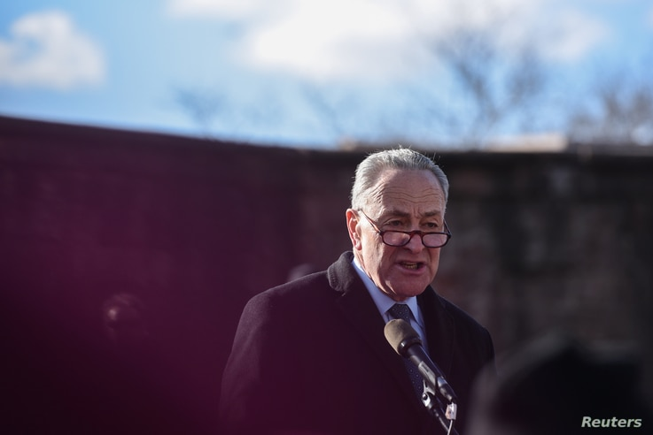 U.S. Senator Chuck Schumer addresses the crowd during a protest against President Donald Trump