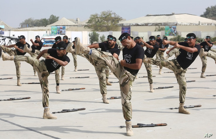 FILE - Commandos of Pakistan's Coast Guards demonstrate their skills during a ceremony in Karachi, Pakistan, Feb. 22, 2018. They are specially trained for counterterror operations.