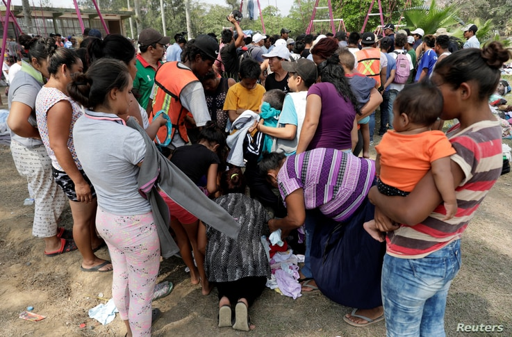 Central American migrants receive donated clothes on their journey to the U.S., in Matias Romero, Oaxaca, Mexico, April 3, 2018.