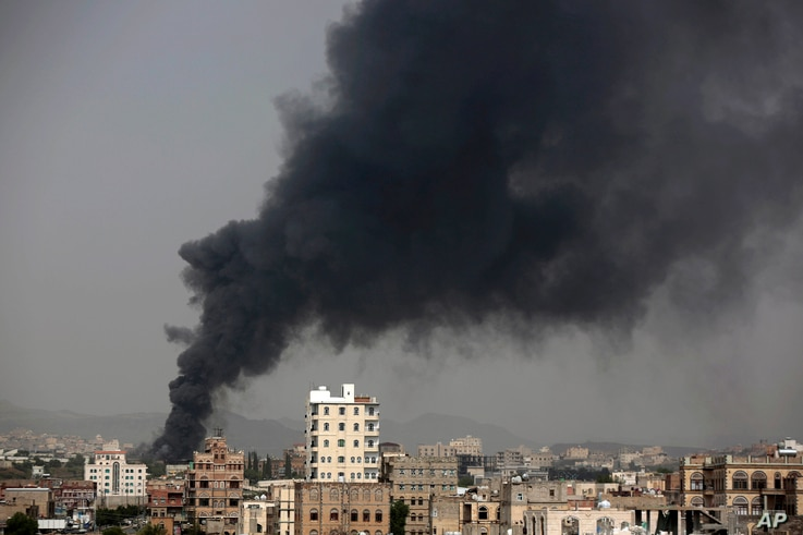 Smoke rises after Saudi-led airstrikes hit a food factory in Sanaa, Yemen, Aug. 9, 2016. In the air campaign by Saudi Arabia and its allies against Yemen's Shiite rebels, rights experts say the Saudi-led coalition is failing to distinguish between ci