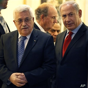 Palestinian president Mahmoud Abbas, left, walks with Israeli Prime Minister Benjamin Netanyahu, right, with Special Middle East Peace Envoy, former Sen. George Mitchell, behind center, in Jerusalem, Wednesday, Sept. 15, 2010.