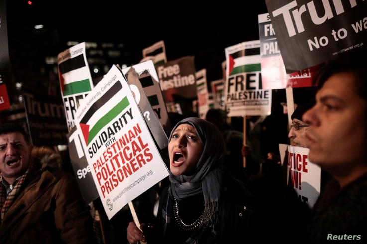 Protesters demonstrate outside the U.S. embassy against President Donald Trump's decision to recognize Jerusalem as Israel's capital, in London, Dec. 8, 2017.
