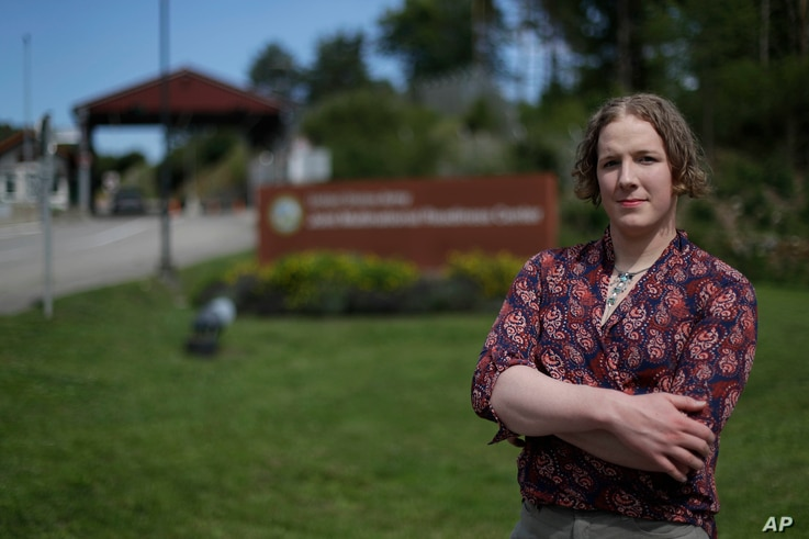 Transgender U.S. Army captain Jennifer Sims poses at the main gate of the Joint Multinational Readiness Center after an interview with The Associated Press in Hohenfels near Regensburg, Germany, July 29, 2017.