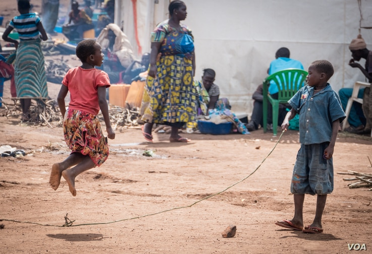 Congolese refugees jump rope at the Kagoma reception center in Kyangwali district Western Uganda. ( H. Athumani for VOA)