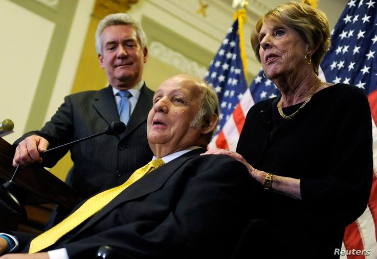 FILE - James Brady (C), former White House Press Secretary under Ronald Reagan, makes remarks with his wife Sarah Brady (R) during a news conference to urge members of Congress for progress on gun control legislation, in Washington, March 30, 2011.