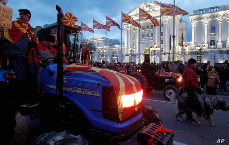 Farmers on tractors participate in a protest in front of the government building in Skopje, Macedonia, March 10, 2017. Thousands of ethnic Macedonians have held evening protests against three ethnic Albanian parties forming a coalition government wit...