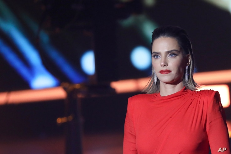 FILE - Rotem Sela, one of Israel's top models and TV hosts, during a tv reality show filming near Jerusalem, Feb. 12, 2019.