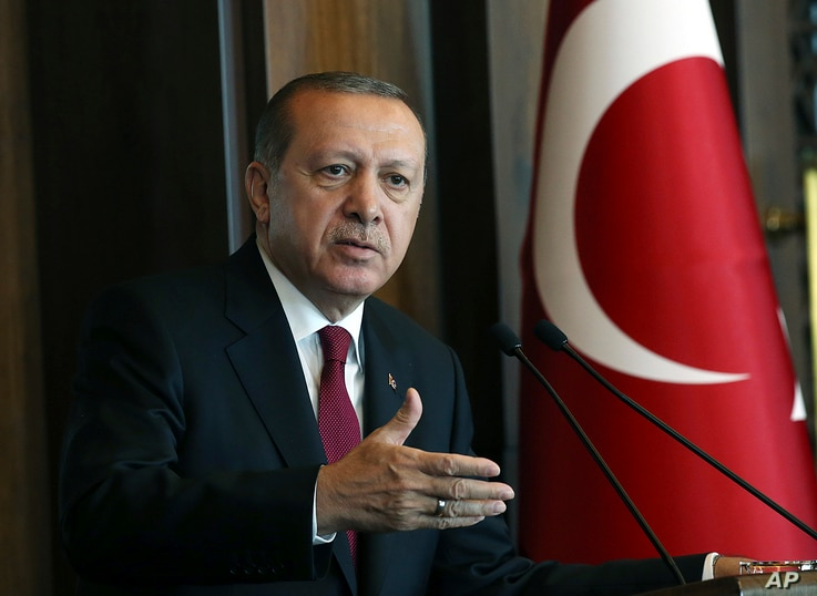 Turkey's President Recep Tayyip Erdogan, delivers a speech during a meeting in Ankara, Oct. 5, 2017. Erdogan has suggested that Turkey, Iran and Iraq are considering blockading Iraq's semi-autonomous region by closing their airspace and borders.