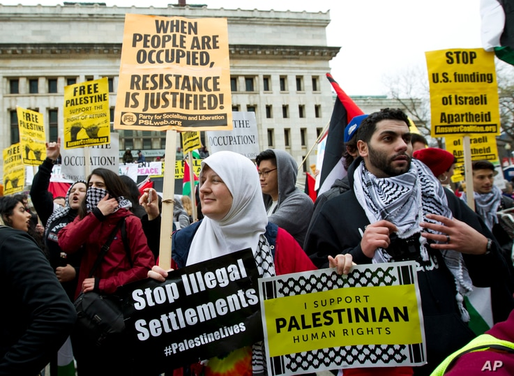 People protest outside of the Washington Convention Center where the 2017 AIPAC Policy Conference is taking place in Washington, March 26, 2017.
