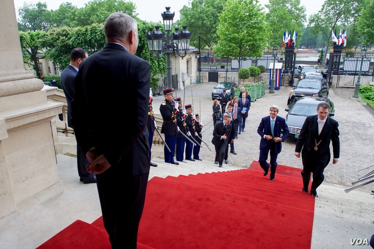 French Foreign Minister Jean-Marc Ayrault, left, welcomes U.S. Secretary of State John Kerry at the Quai d'Orsay -- the French Foreign Ministry -- in Paris, France, before a bilateral meeting, June 4, 2016.