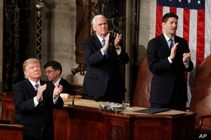 "President Donald Trump, Vice President Mike Pence and House Speaker Paul Ryan applaud Carryn Owens, widow of Navy SEAL William ""Ryan"" Owens, on Capitol Hill in Washington, Feb. 28, 2017, during the president's address before a joint session of Co..."