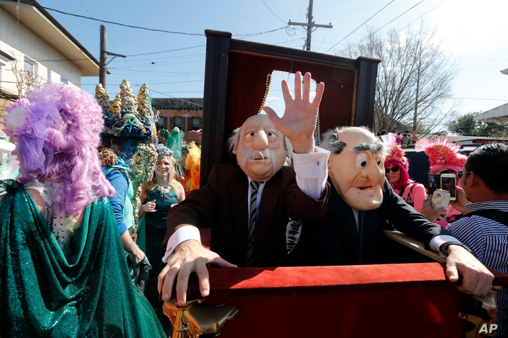 Revelers march during the Society de Sainte Anne parade, on Mardi Gras day in New Orleans, Tuesday, Feb. 13, 2018.