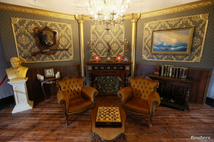 """A view shows an interactive mock-up of a corrupt official's room filled with real examples of bureaucratic excess, at the """"Corruption Park"""" in Kyiv, Ukraine, June 14, 2018."""