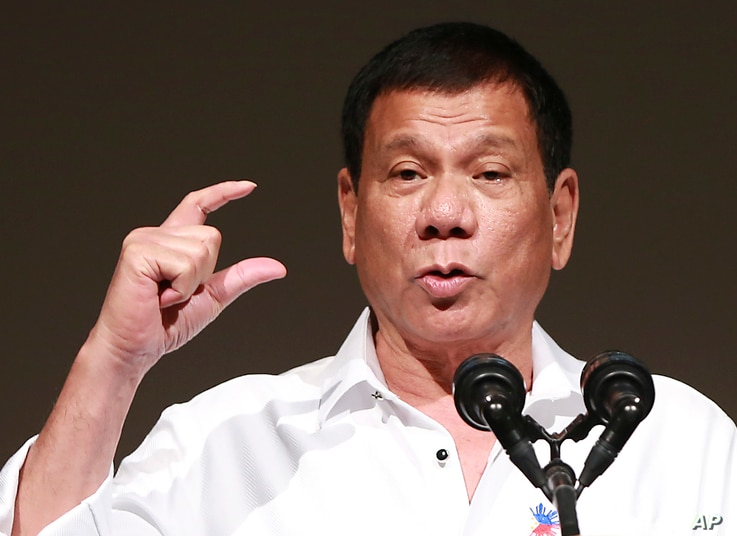 FILE - Philippine President Rodrigo Duterte delivers a speech at the Philippine Economic Forum in Tokyo, Oct. 26, 2016.