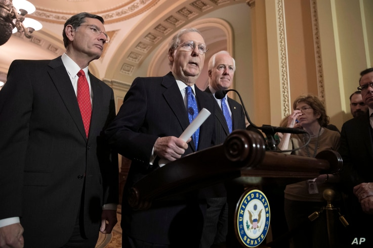 Senate Majority Leader Mitch McConnell, R-Ky., flanked by Sen. John Barrasso, R-Wyo., left, and Majority Whip John Cornyn, R-Texas, speaks to reporters about efforts to avoid a government shutdown this weekend, at the Capitol in Washington, Jan. 17, ...