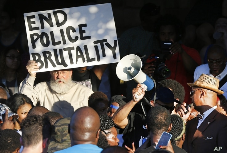 Demonstrators gather near a community pool during a protest Monday, June 8, 2015, in response to an incident at the pool involving McKinney police officers in McKinney, Texas.