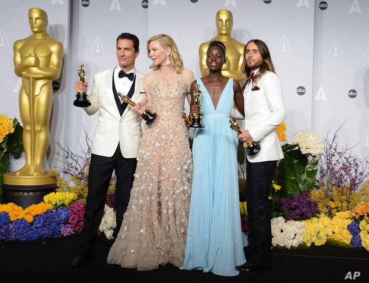 From Left, Matthew McConaughey, Cate Blanchett, Lupita Nyong'o, and Jared Leto pose in the press room with their awards during the Oscars at the Dolby Theatre, March 2, 2014, in Los Angeles.