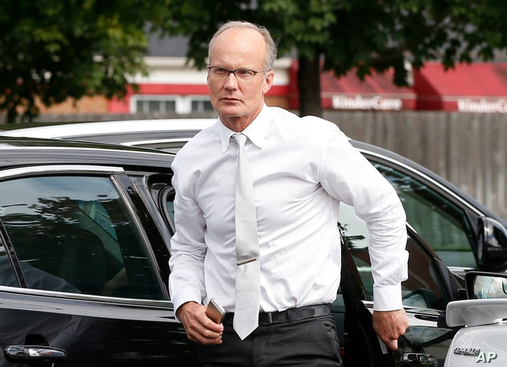 FILE - U.S. Dentist Walter Palmer, who for weeks stayed out of the public eye after being identified as the hunter who killed Cecil the lion, is seen outside his practice in Bloomington, Minnesota, Sept. 8, 2015.