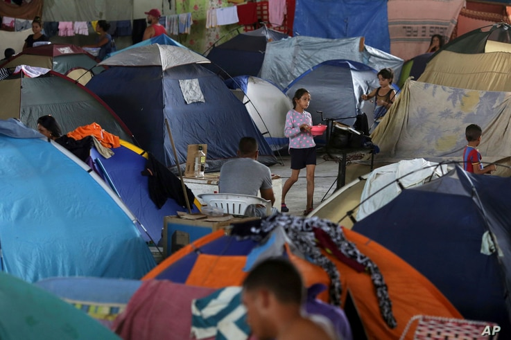 n this March 8, 2018 photo, tents fill the Tancredo Neves Gymnasium that is operating as a shelter for Venezuelans in Boa Vista, Roraima state, Brazil.