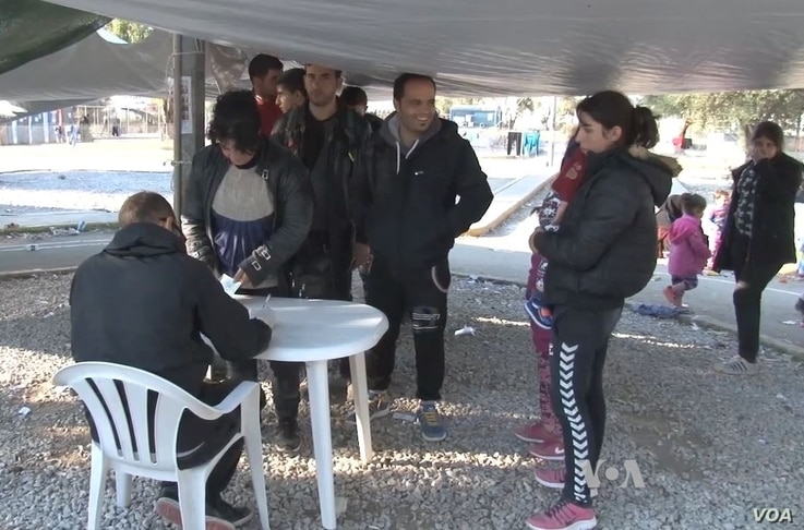 As migrants streamed into the Karatepes registration camp Saturday on the Greek island of Lesbos, many smiled as they clutched bags, suitcases and the hands of small children. It is their first stop after what was for many a harrowing boat ride from ...