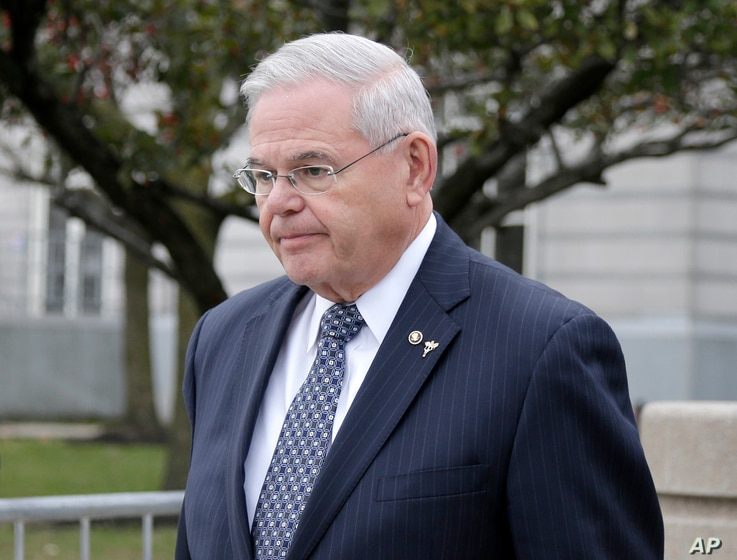Democratic U.S. Sen. Bob Menendez leaves the federal courthouse in Newark, New Jersey, Nov. 13, 2017.