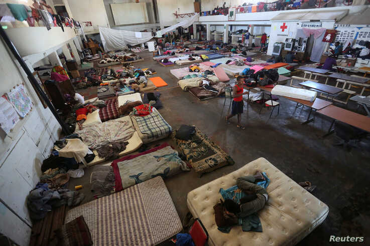 African and Haitian migrants intending to seek asylum in the U.S. rest on mattresses inside a shelter in Mexicali, Mexico, Oct. 5, 2016.