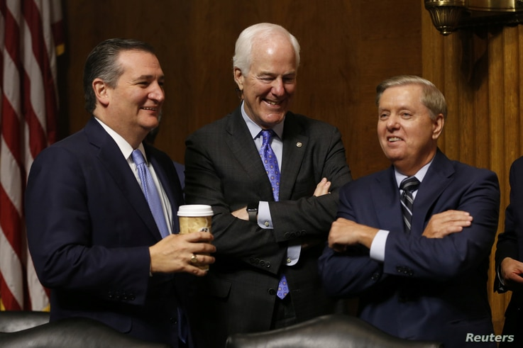 Republican Senators Ted Cruz, left, John Cornyn, center, and Lindsey Graham, right, chat during a break in the hearing on the nomination of Brett Kavanaugh to be an associate justice of the Supreme Court of the United States, on Capitol Hill in Washi...