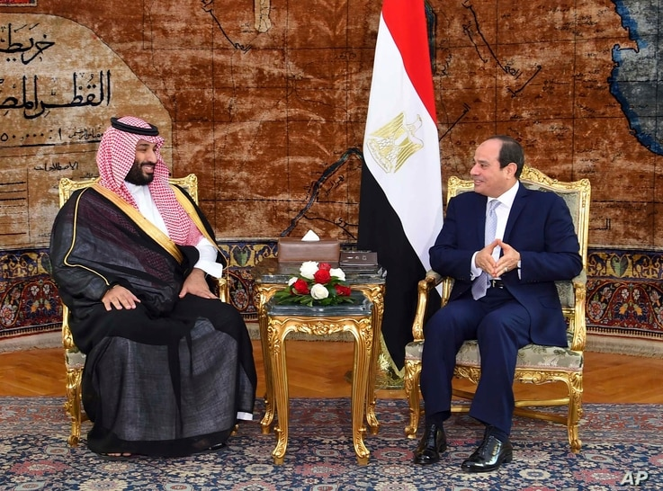 In this photo released by the Egyptian presidency's office, Saudi Arabia's Crown Prince Mohammed bin Salman, left, meets with Egyptian President Abdel Fattah el-Sisi in Cairo, Nov. 27, 2018.