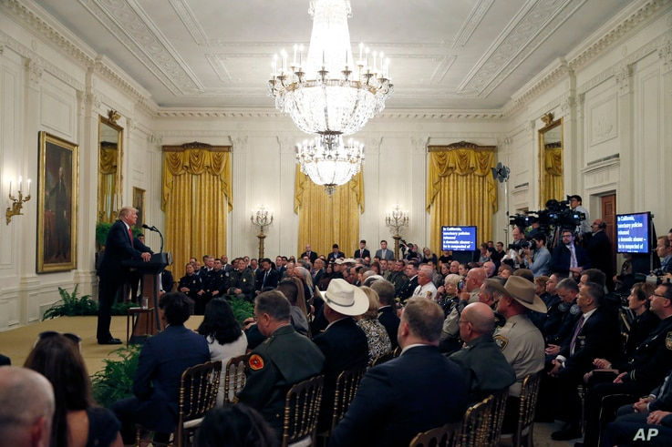 President Donald Trump speaks during an event to salute U.S. Immigration and Customs Enforcement (ICE) officers and U.S. Customs and Border Protection (CBP) agents in the East Room of the White House in Washington, Aug. 20, 2018.