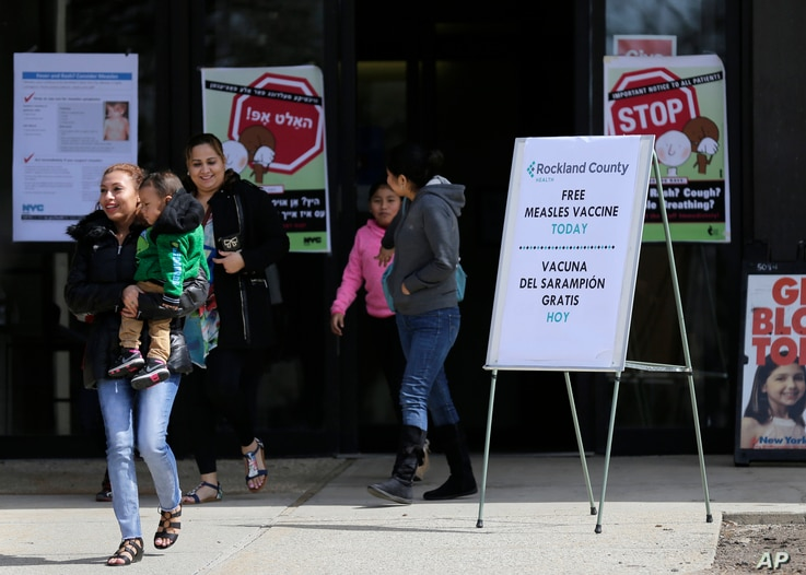 Sign advertising free measles vaccines and information about measles are displayed at the Rockland County Health Department in Pomona, N.Y., March 27, 2019. The county in New York City's northern suburbs declared a local state of emergency Tuesday ov...