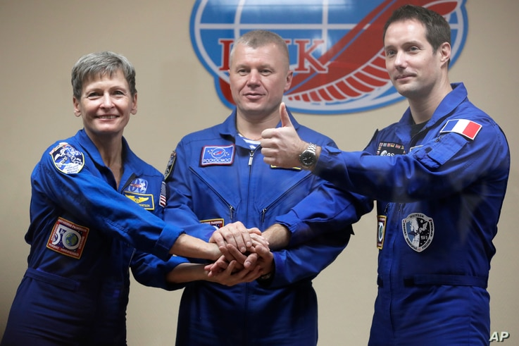 French astronaut Thomas Pesquet (right) Russian cosmonaut Oleg Novitsky and U.S. astronaut Peggy Whitson, members of the main crew to the International Space Station, pose after a news conference in Russian leased Baikonur cosmodrome, Kazakhstan, No...