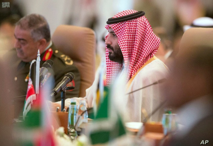 FILE - In this photo released by the state-run Saudi Press Agency, Saudi Crown Prince Mohammed bin Salman speaks at a meeting of the Islamic Military Counter Terrorism Coalition in Riyadh, Saudi Arabia, Nov. 26, 2017.