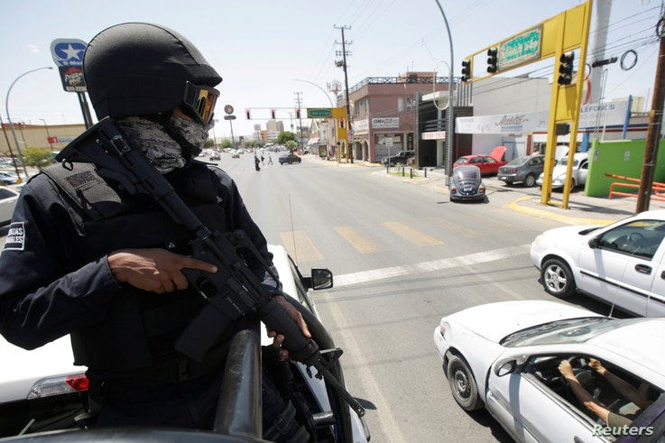 A state policeman patrols the streets as he and his team reinforce security with more than 90 police officers, after a wave of violence in the last few days and to prepare for the visit of President-elect Andres Manuel Lopez Obrador, in Ciudad Juarez...