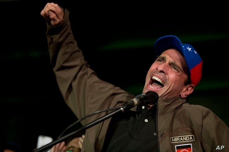 Venezuelan opposition leader Henrique Capriles speaks to supporters and reporters during a meeting in Caracas, April, 7, 2017. Capriles announced that he has been banned from running for office for 15 years.
