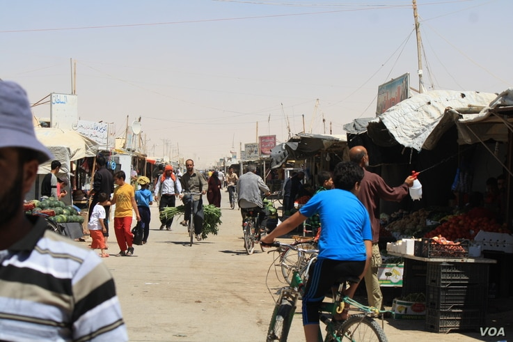 More than 80,000 people now live in the Za'atari camp in Jordan, and many say social media is their main source of news and communication with their families and friends still trapped in the war zones. (Credit: VOA/Heather Murdock)