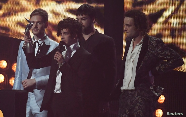 The 1975 accept the award for Best british group at the Brit Awards at the O2 Arena in London, Feb. 22, 2017.