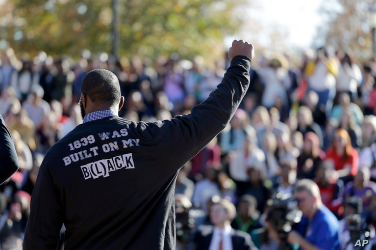 A member of the black student protest group Concerned Student 1950 gestures while addressing a crowd following the announcement that University of Missouri System President Tim Wolfe would resign, Nov. 9, 2015, at the university in Columbia, Missouri...