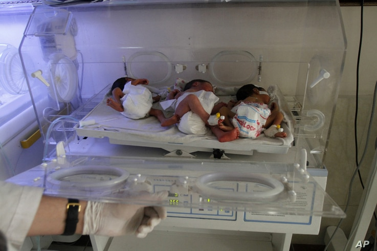 In this May 7, 2015 photo, new born Afghan babies are seen at Indira Gandhi children's hospital, and neonatal ward in Kabul, Afghanistan.