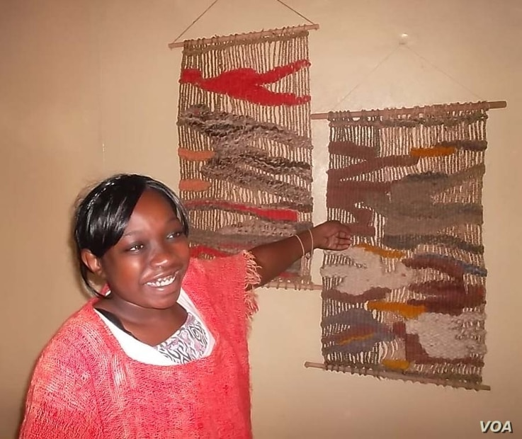 Okello's daughter, Linet Lydia Atieno, displays Kapendeza products (VOA/Ajanga Khayesi)