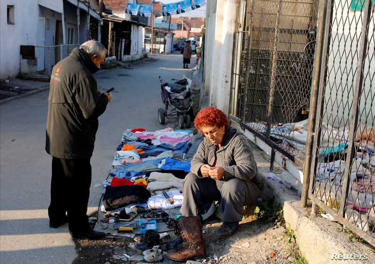 A vendor sells second-hand items in Suto Orizari, a district with Europe's largest Roma communities, Macedonia, Dec. 2, 2016.