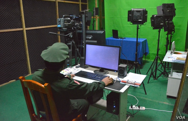 A KIA officer is seen in the studio of Laiza TV. (P. Vrieze for VOA)